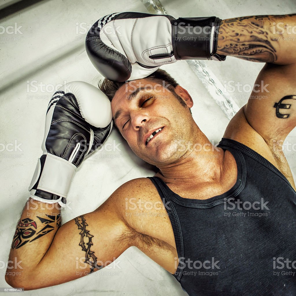 Unconscious Boxer to the Mat stock photo