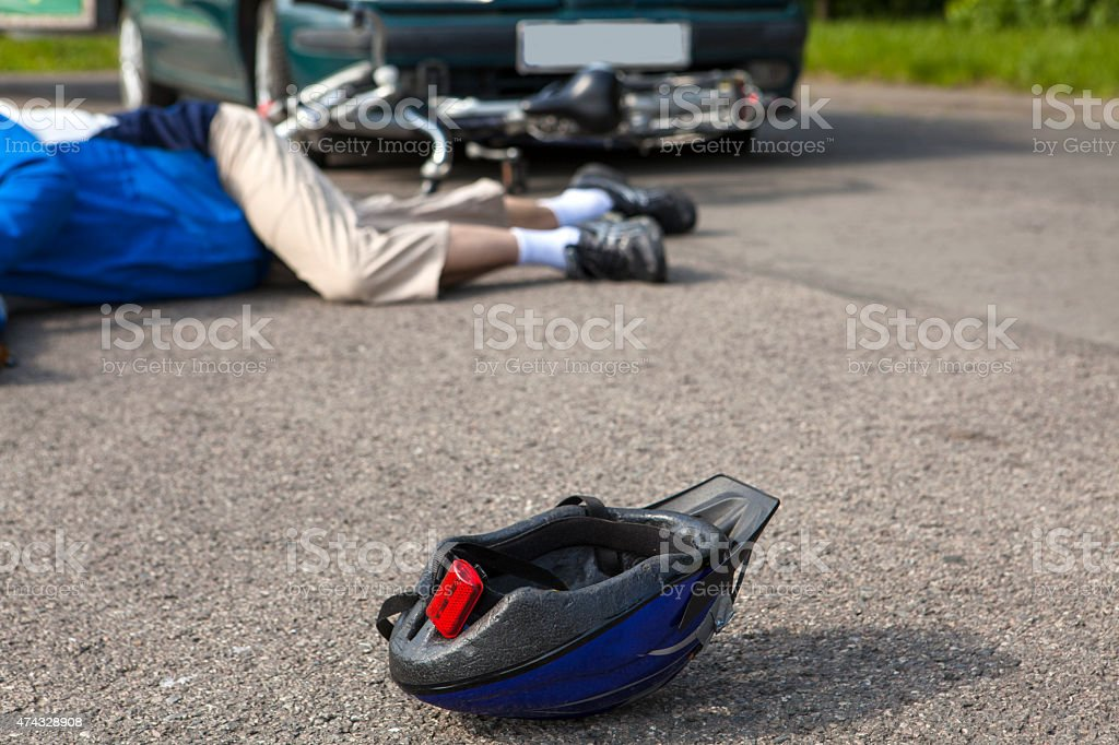 Unconscious Cyclist after a road accident stock photo