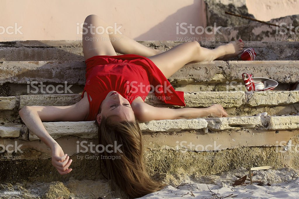 unconscious woman  on the stairs royalty-free stock photo