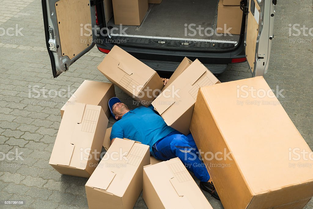 Unconscious Worker Lying On Street stock photo