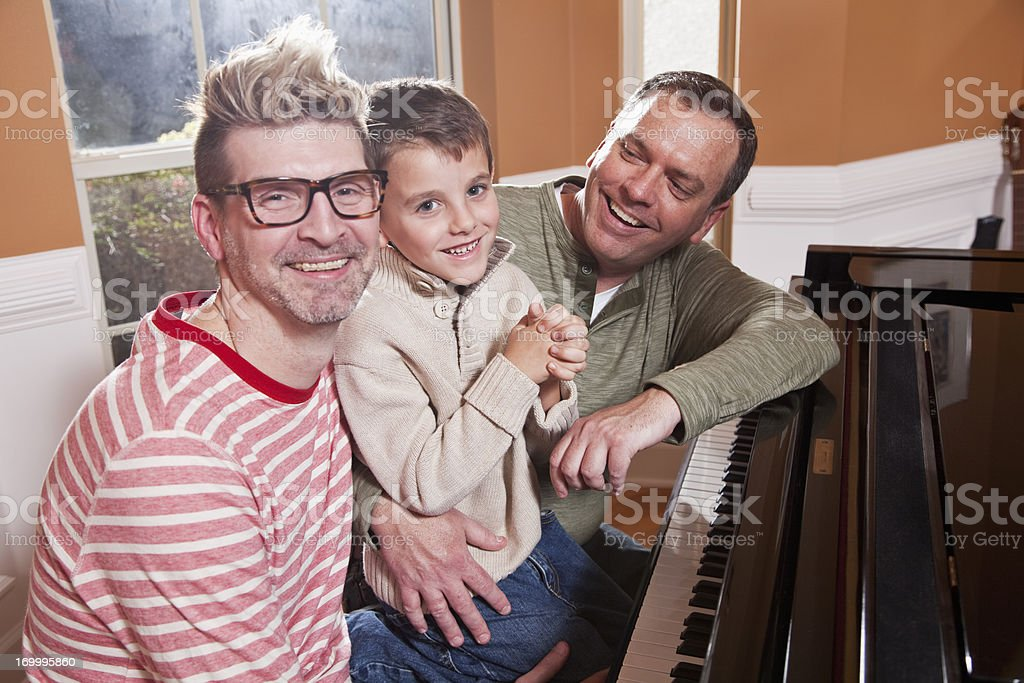 Unconventional family at the piano stock photo