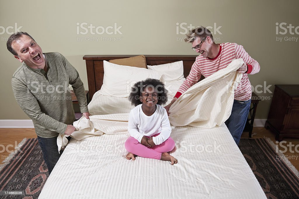 Unconventional family doing housework stock photo