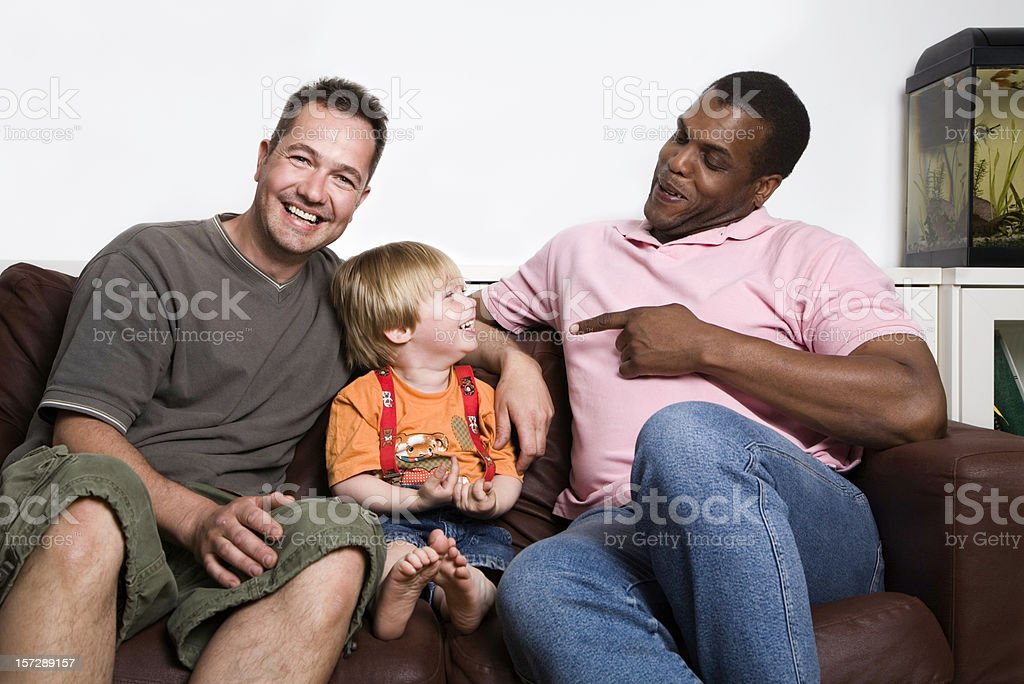 Unconventional family, two men and a child. royalty-free stock photo