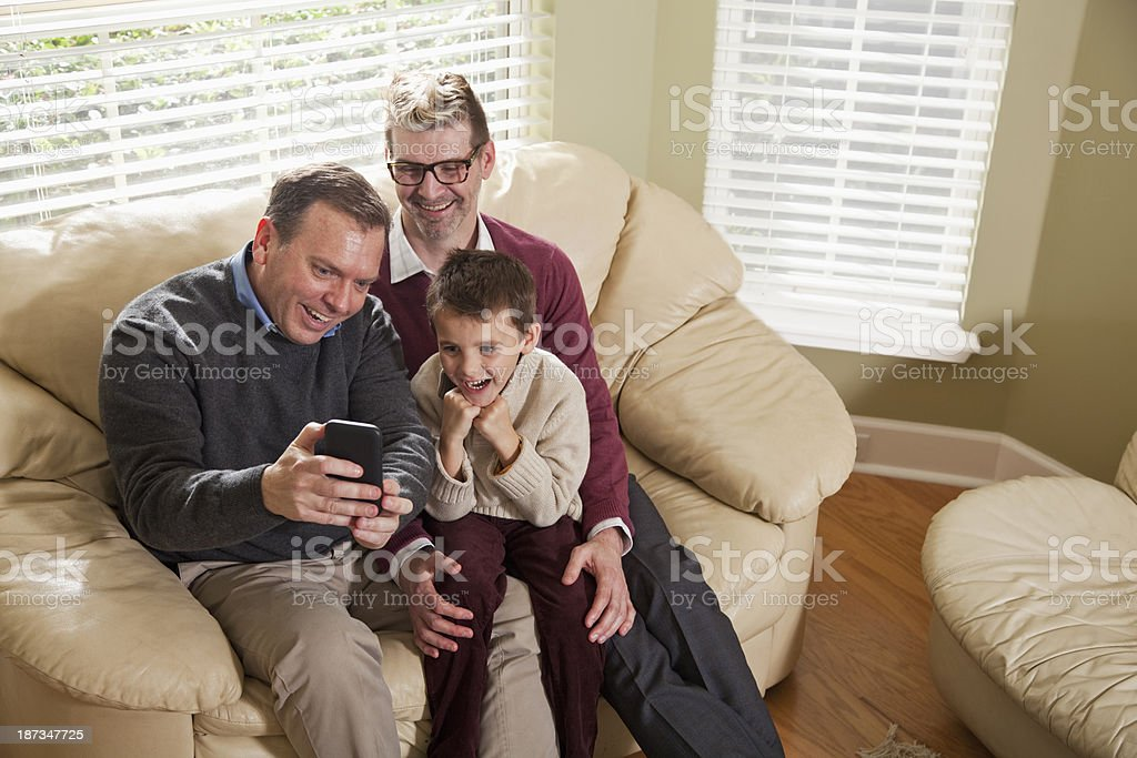 Unconventional family, using mobile phone stock photo