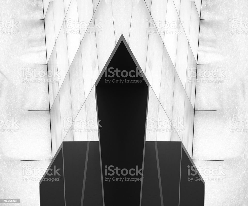 Unconventional polyhedron object in modern interior with paneled walls stock photo