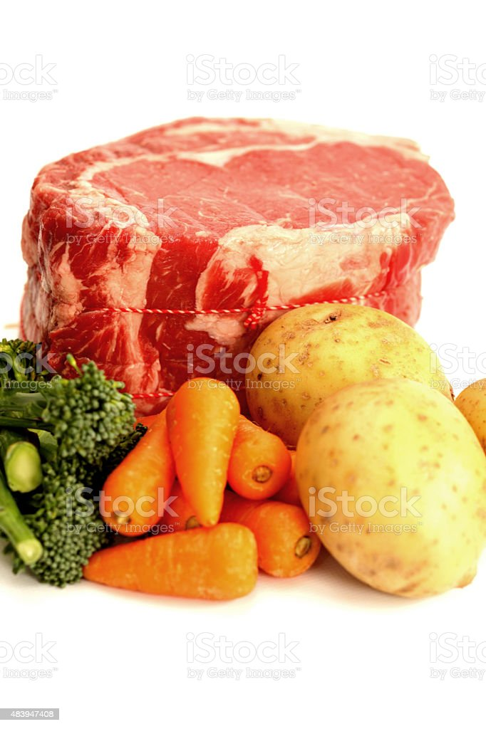 Uncooked Beef Rib Joint With Vegetables stock photo