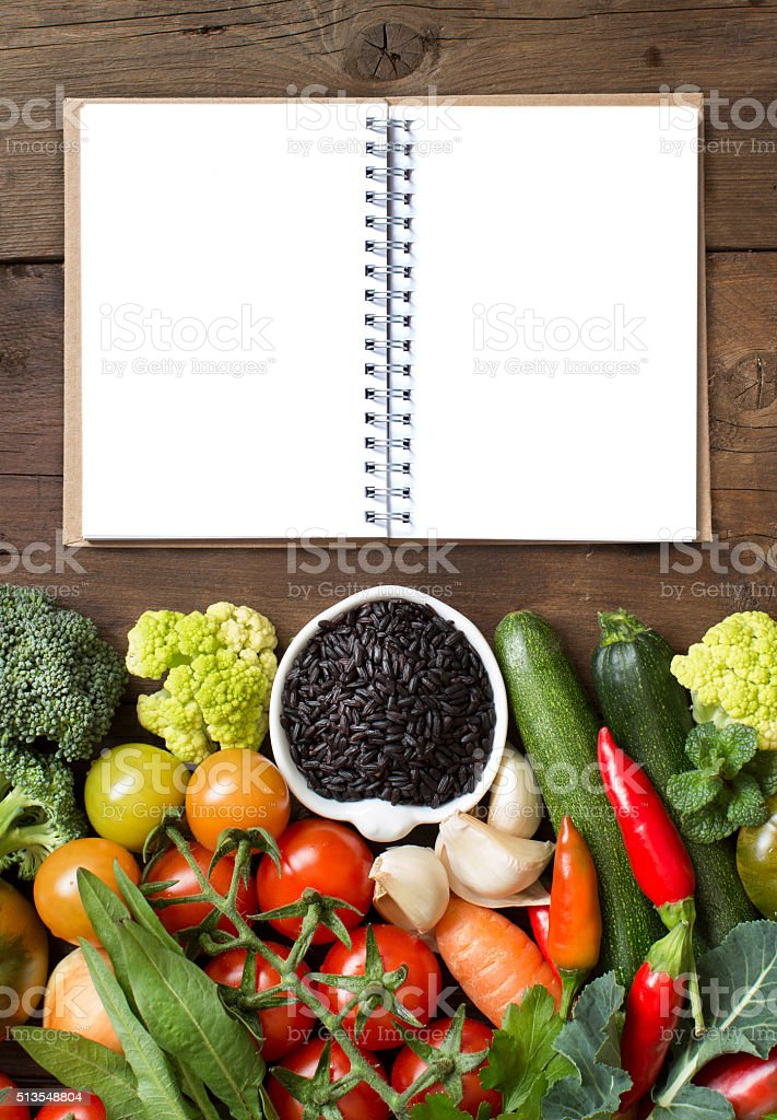 Uncooked black rice with vegetables and notebook stock photo