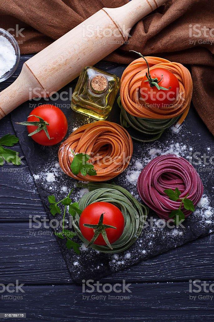 Uncooked color pasta tagliatelle stock photo