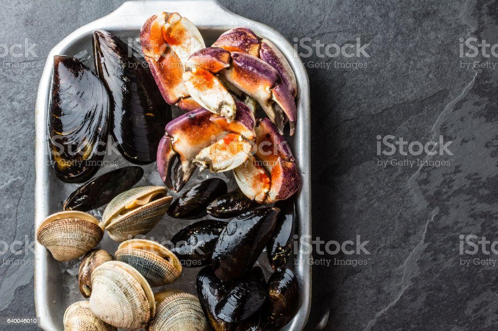 Uncooked fresh seafood Mussels, Clams, Vongole and Crabs stock photo