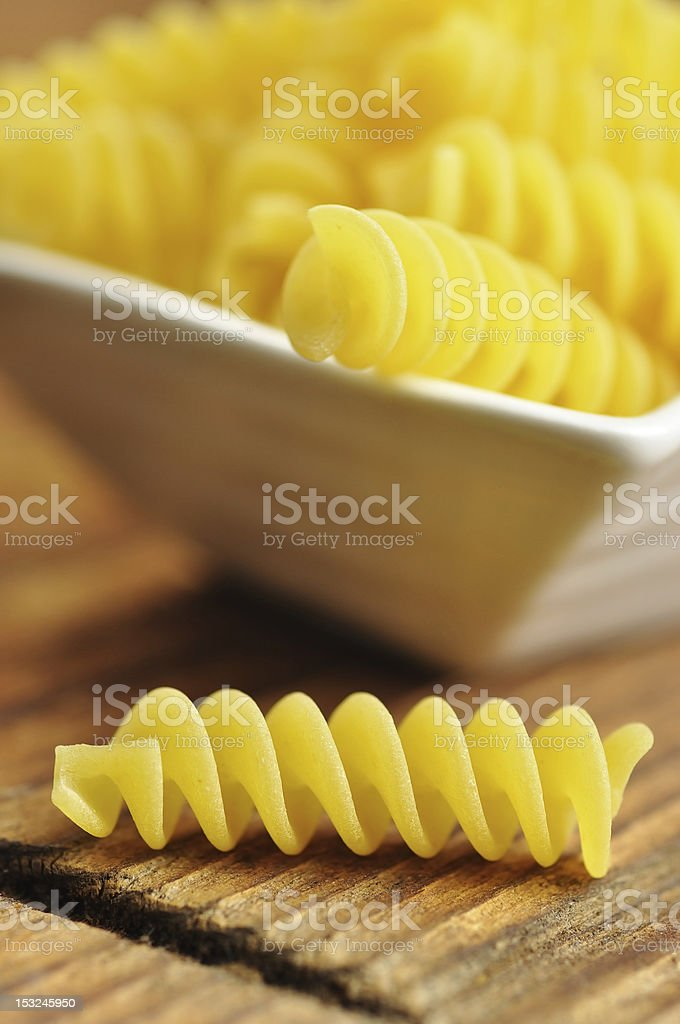 Uncooked fusilli, italian pasta, closeup royalty-free stock photo