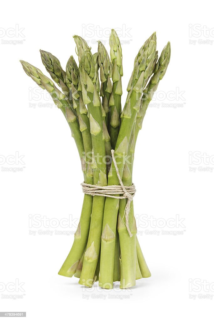 uncooked green asparagus tied with twine stock photo