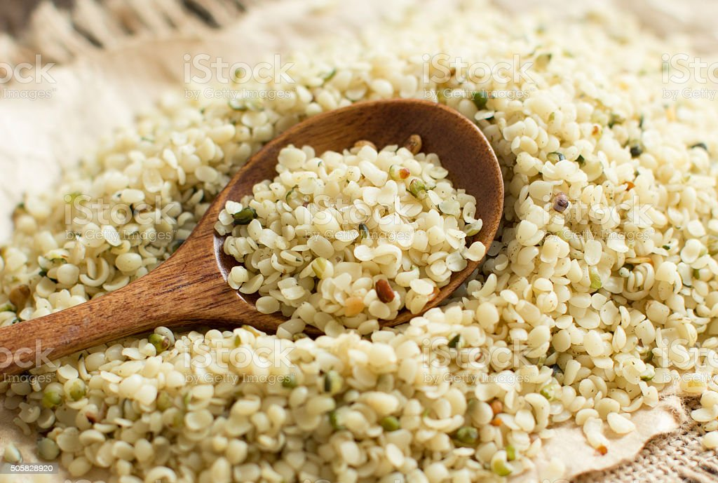 Uncooked Hemp seeds with a spoon stock photo