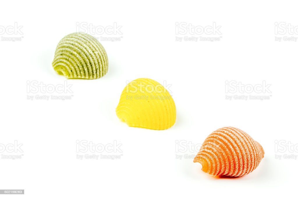Uncooked Italian conchiglie pasta on a white background royalty-free stock photo