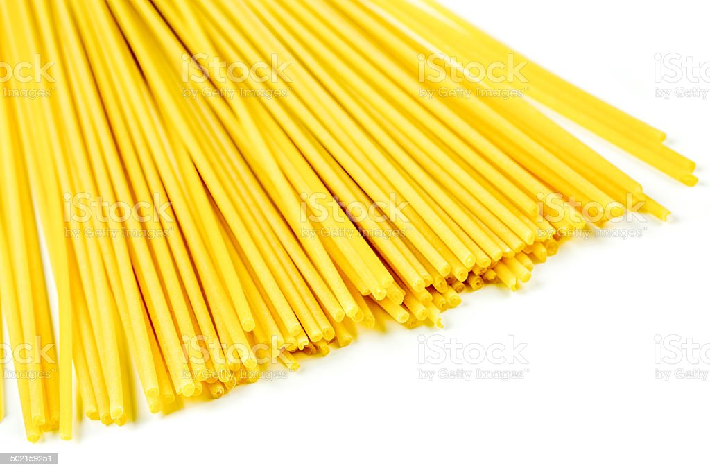 Uncooked Italian spaghetti on a white background royalty-free stock photo