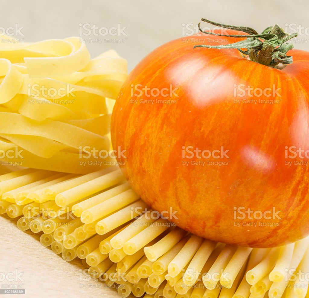 Uncooked Italian tagliatelle on a white background royalty-free stock photo
