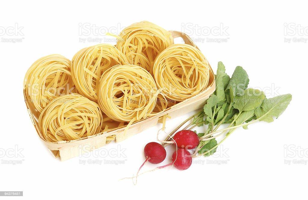 Uncooked macaroni and radish royalty-free stock photo