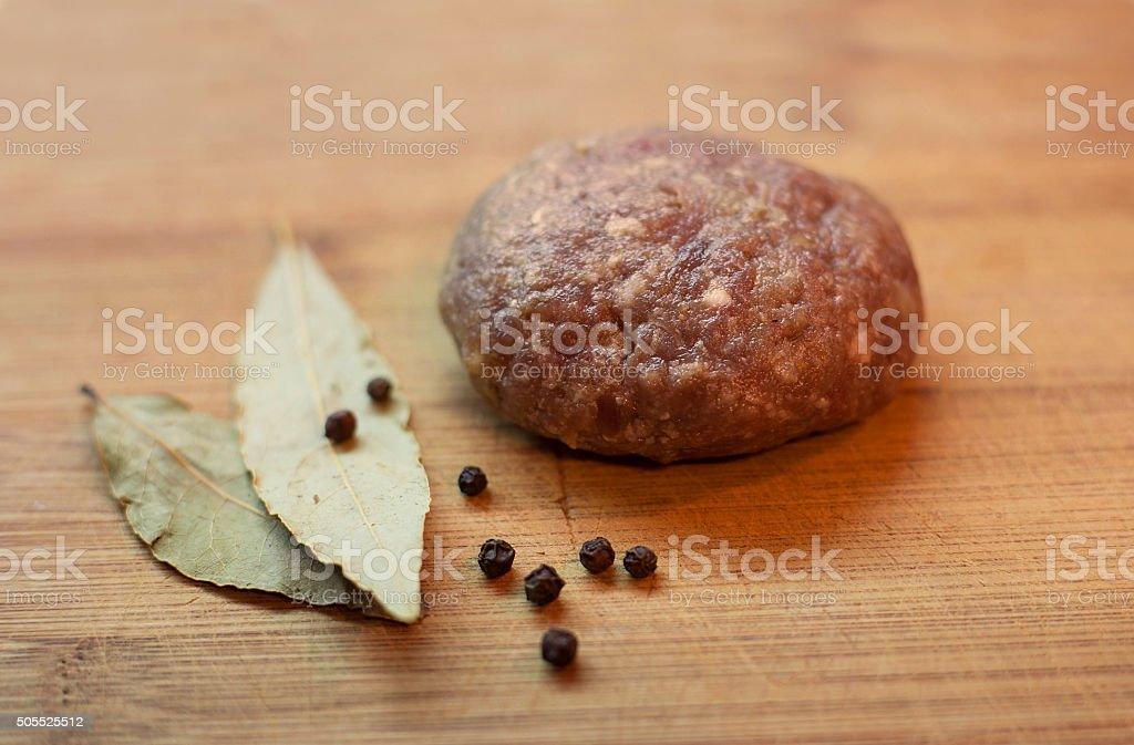 Uncooked meat cutlet stock photo