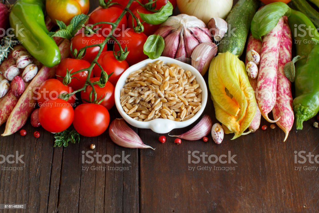 Uncooked mixed kamut with vegetables stock photo