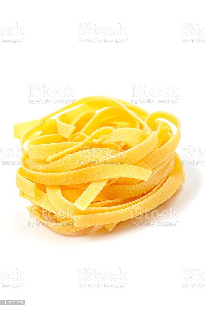 Uncooked pasta nest royalty-free stock photo