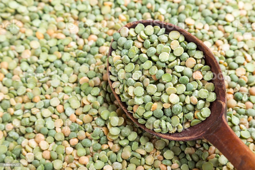 uncooked peas is scattered background stock photo