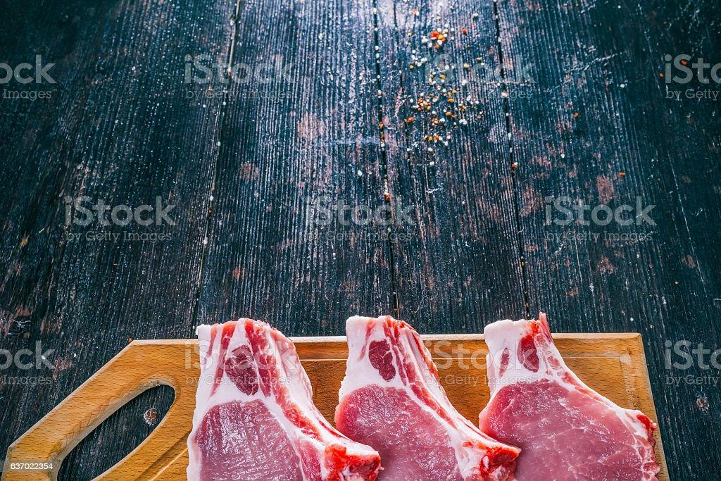 Uncooked pork steaks stock photo