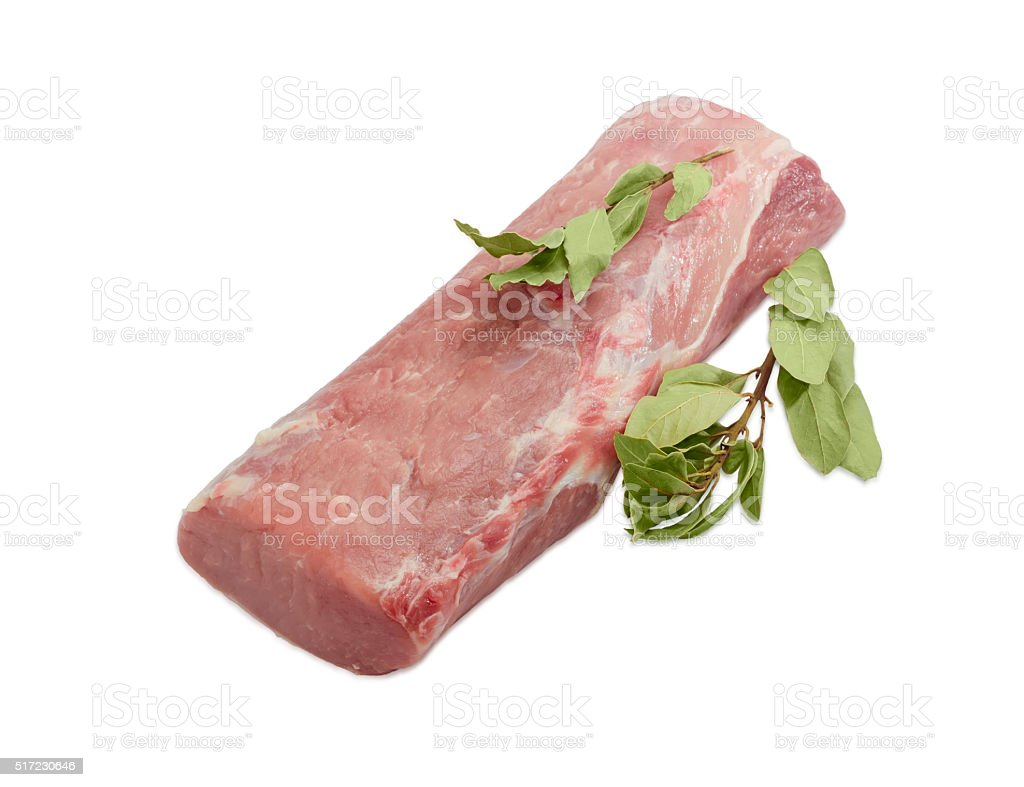 Uncooked pork tenderloin and bay leaf on light background stock photo