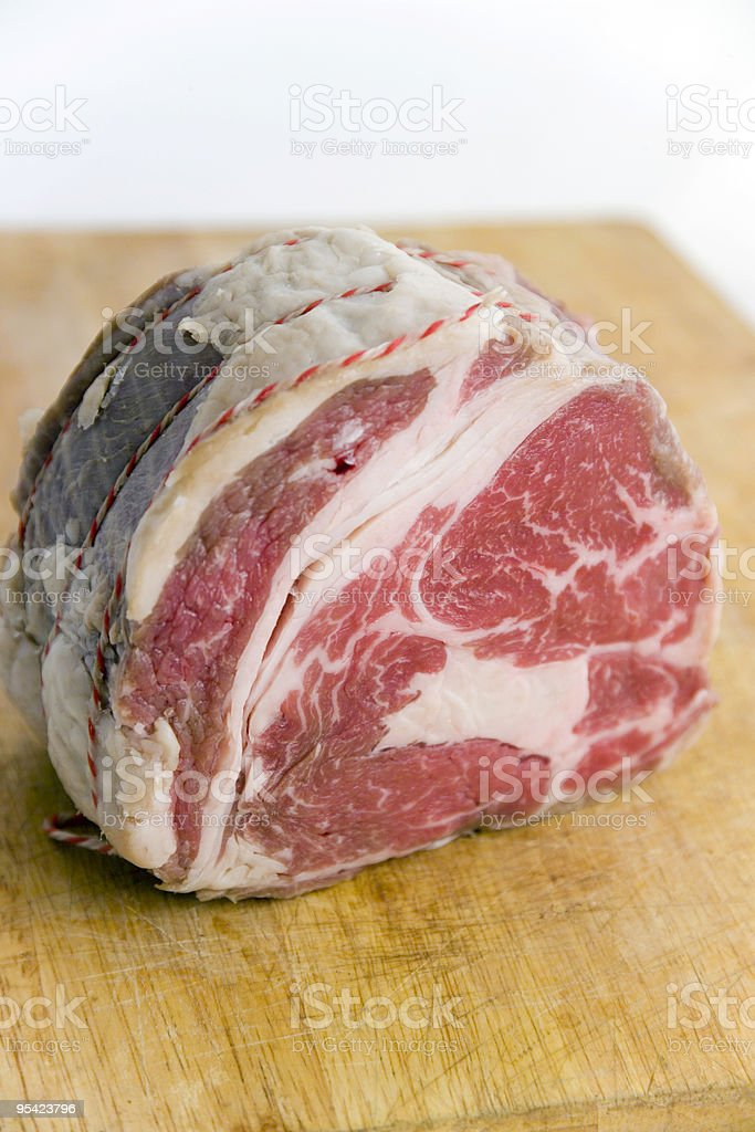 Un-cooked Rib Roast on board royalty-free stock photo