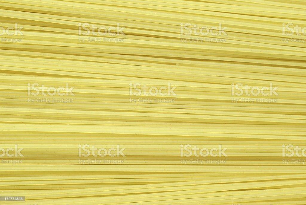 Uncooked spaghetti pasta layer royalty-free stock photo