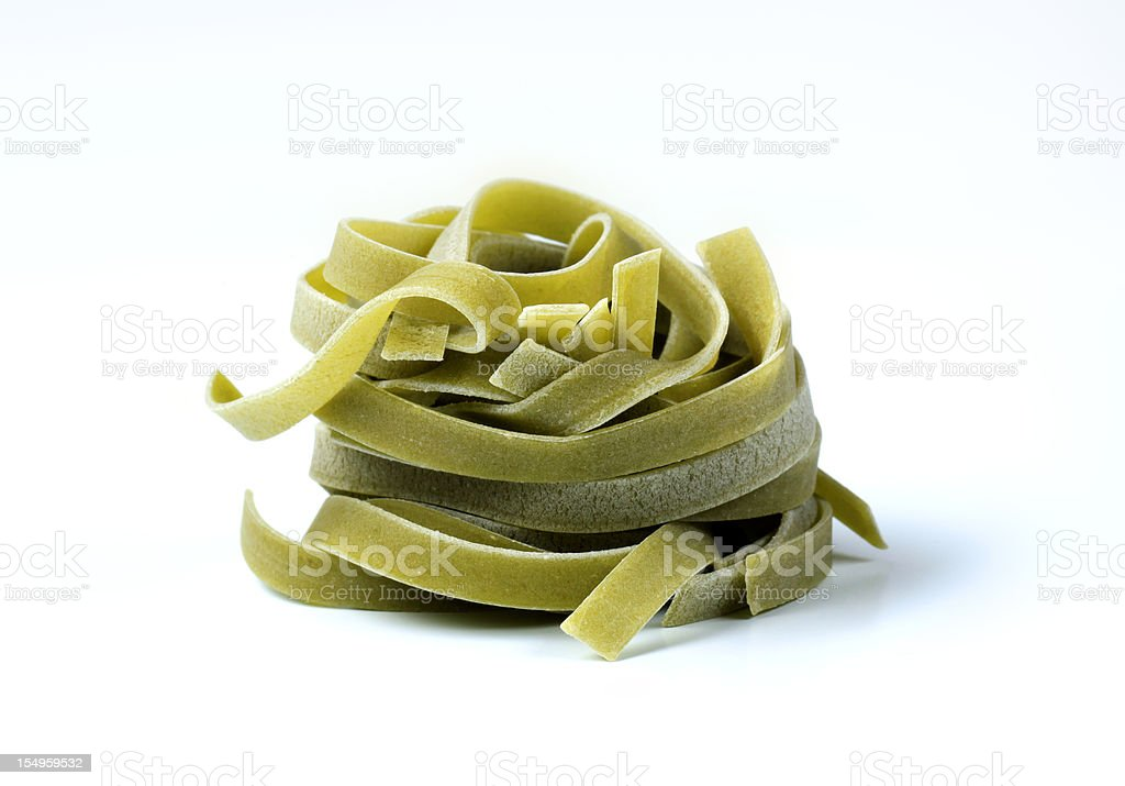 Uncooked spinach ribbon pasta stock photo