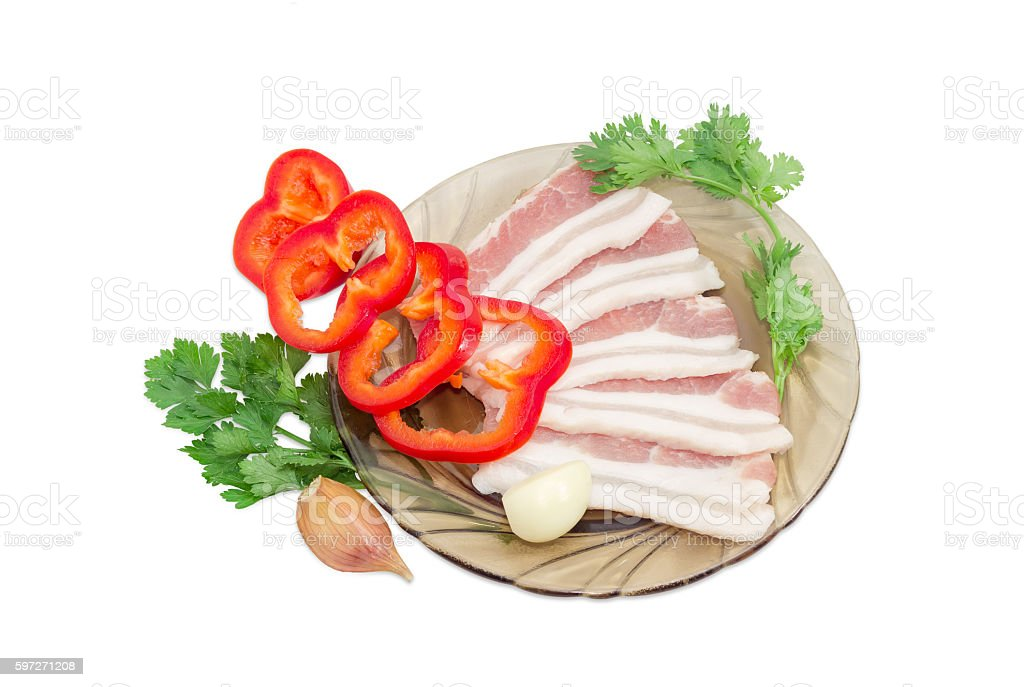 Uncooked streaky bacon, bell pepper, sprigs parsley and coriande stock photo