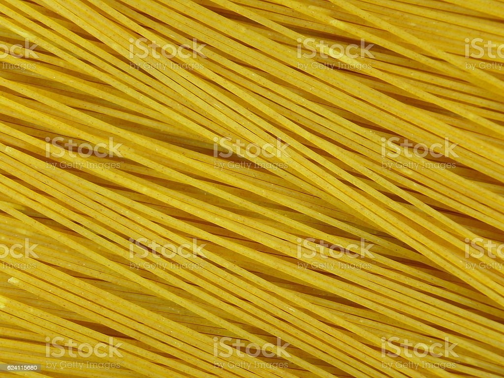 Uncooked Whole Wheat Spaghetti, Close-up for Texture, Background stock photo