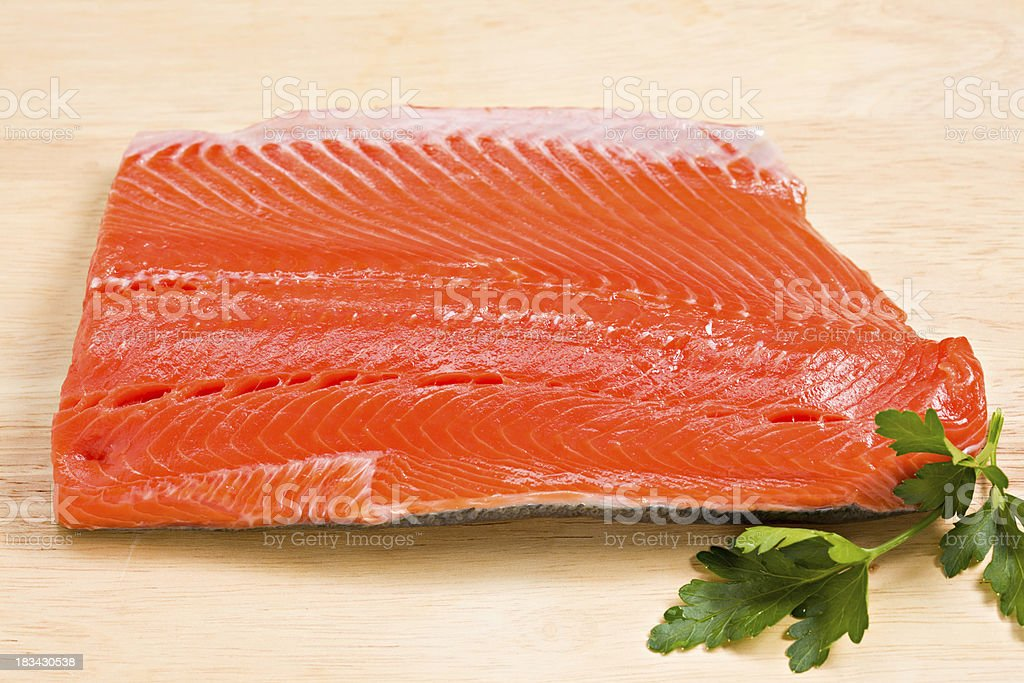 Uncooked Wild Sockeye Salmon With Parsley royalty-free stock photo