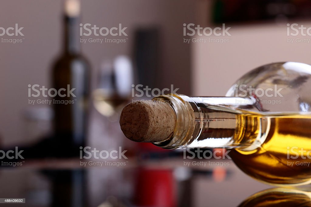 Uncorked bottle of white wine stock photo