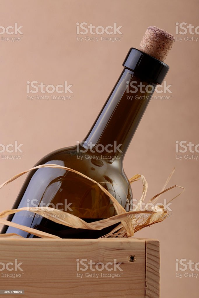 Uncorked bottle of wine in box stock photo