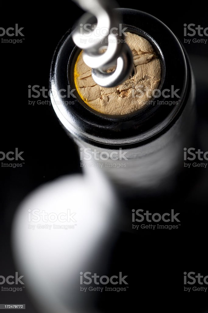 Uncorking a bottle of wine stock photo