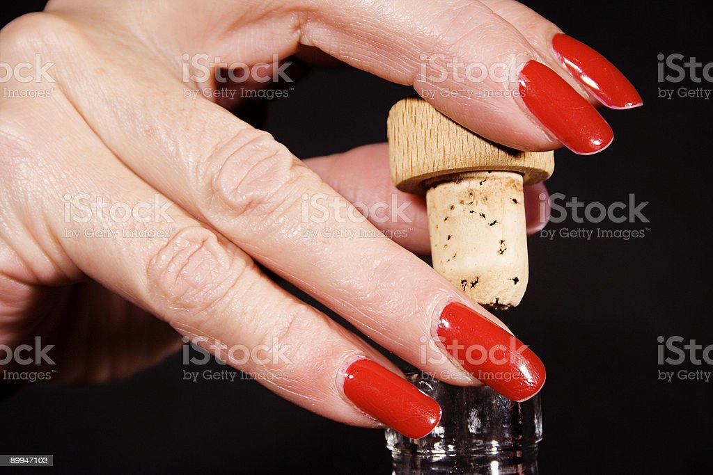 Uncorking a Wine Bottle royalty-free stock photo
