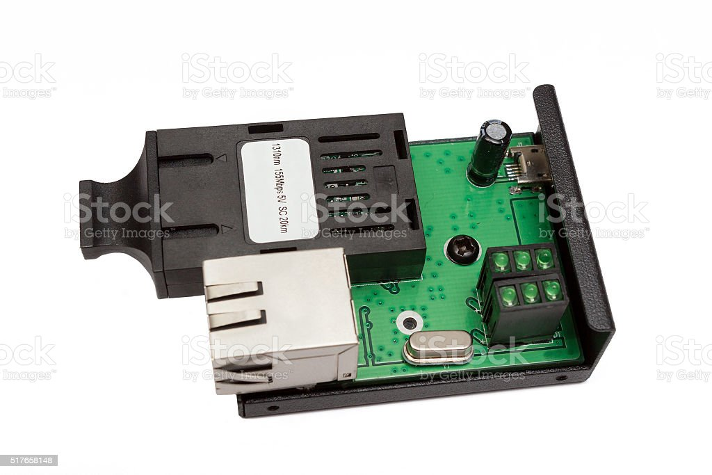uncovered mini fiber optic Media converter stock photo