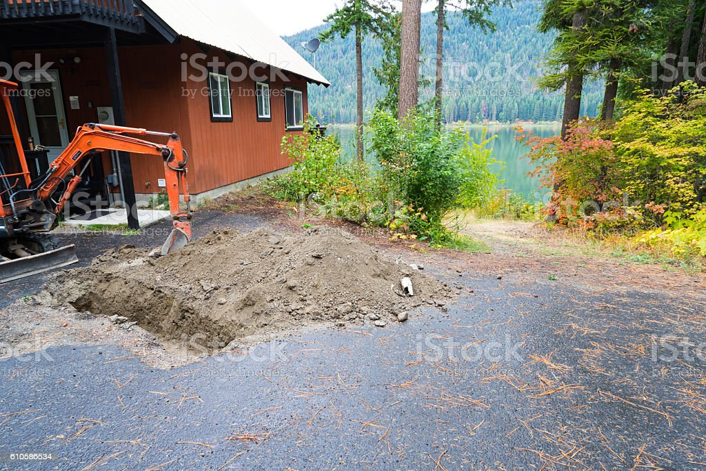 Uncovering Septic Tank stock photo
