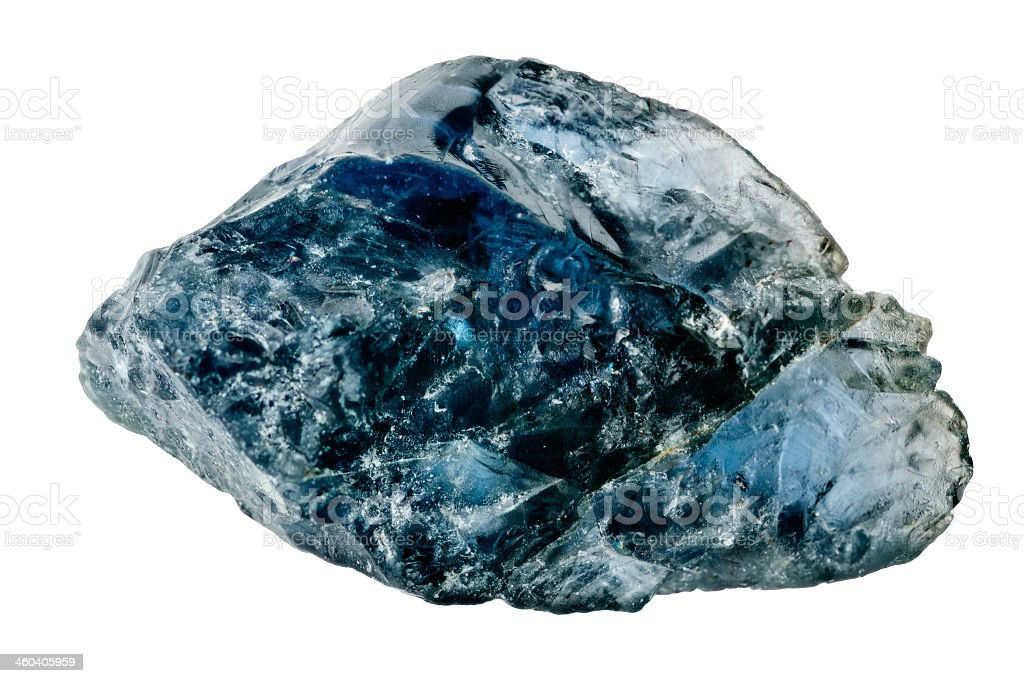 Uncut blue sapphire against white background stock photo