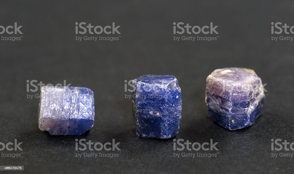 Uncut sapphires from Madagascar. 1cm long. stock photo