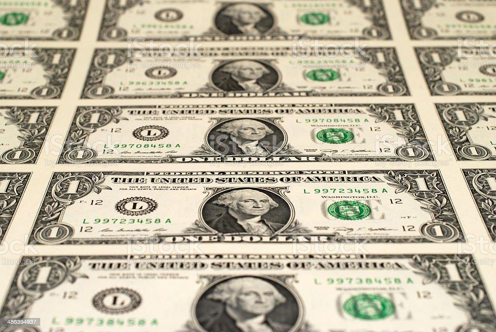 Uncut Sheet of One Dollar Bills stock photo