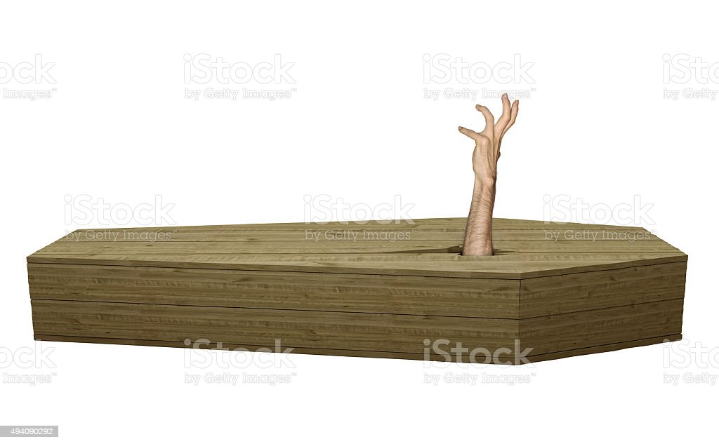 Undead zombie hand breaking out of wood coffin on Halloween stock photo