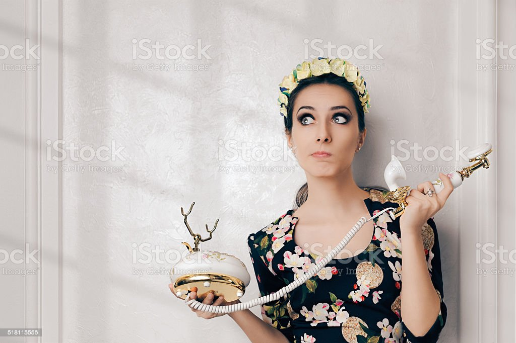 Undecided Retro Woman Ready With Vintage Phone stock photo