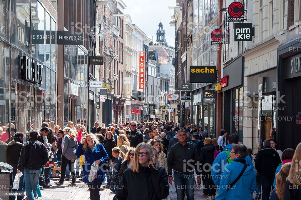Undefined people on Kalverstraat shopping street, the Netherlands. stock photo