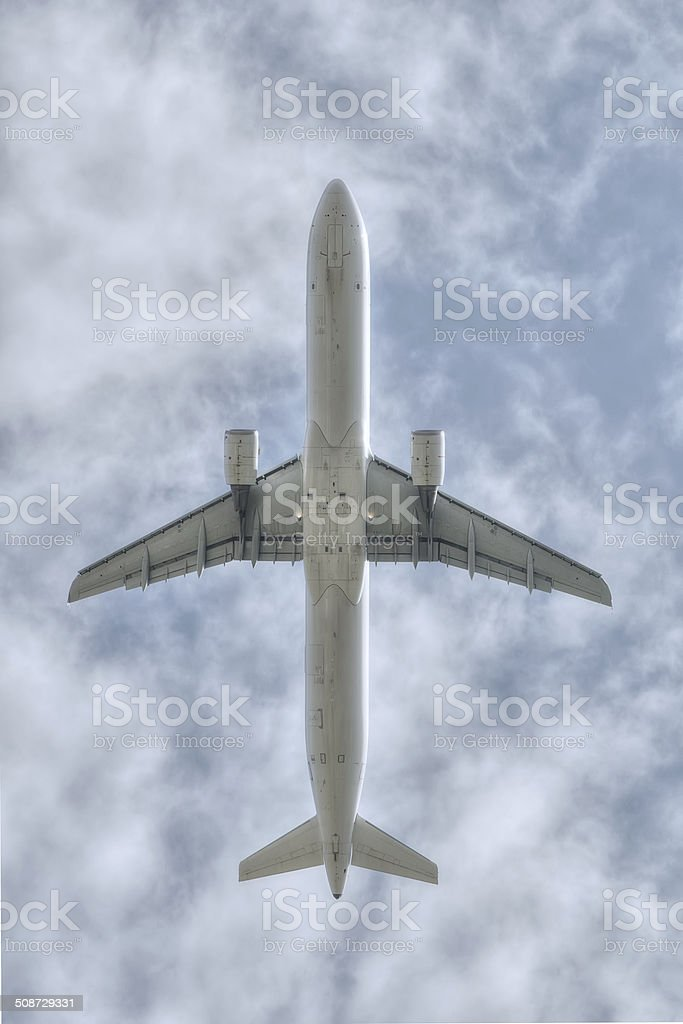 under a flying big jet plane royalty-free stock photo