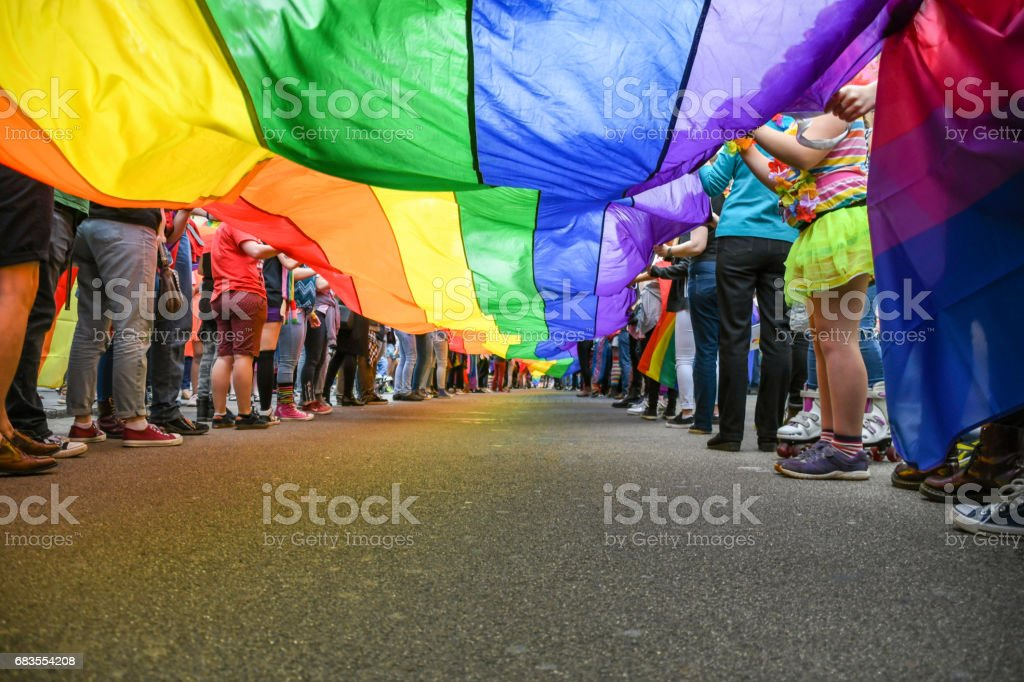 Under a LGBT Pride Flag stock photo