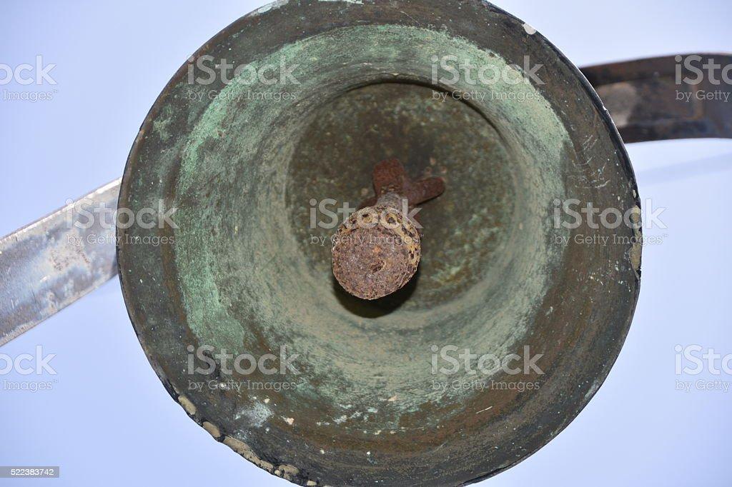 Under an old brass bell stock photo