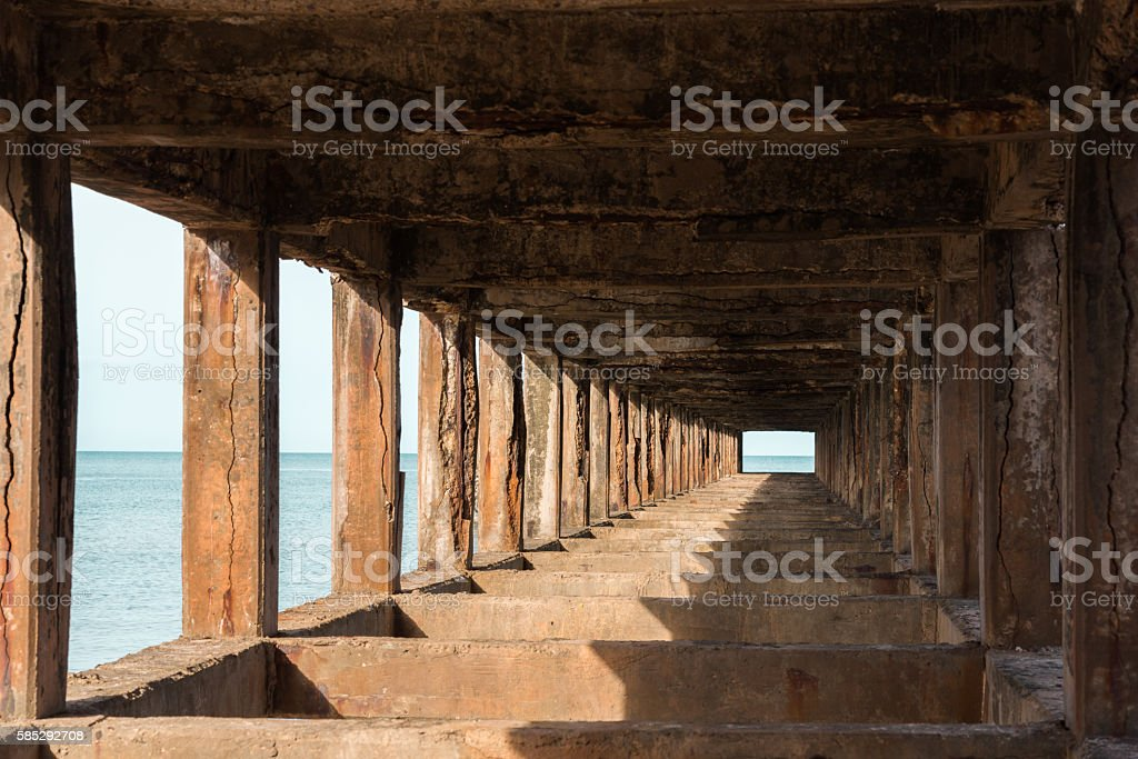 Under construction old cement bridge into the sea, Thailand stock photo