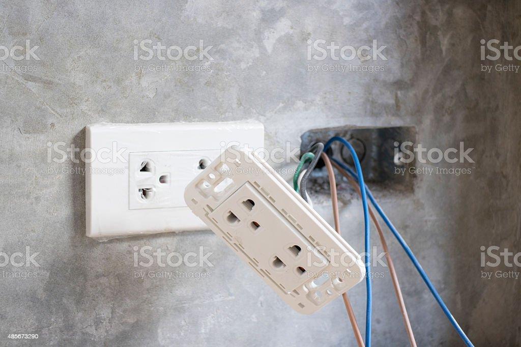 Under construction plug socket stock photo