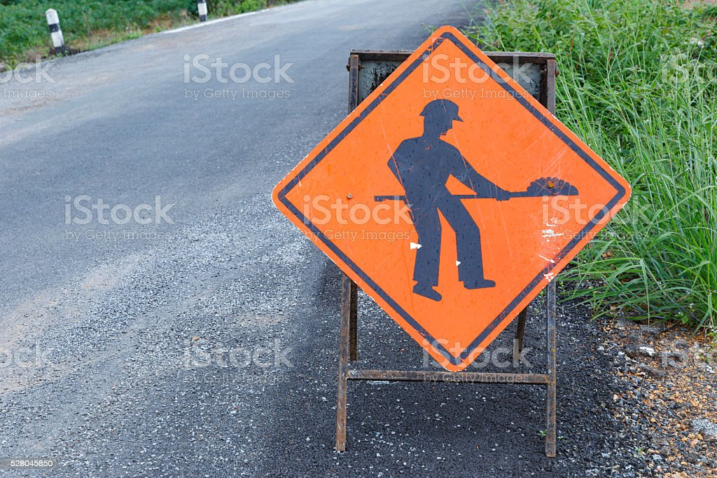 Under construction sign of damage road stock photo